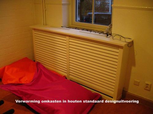 Pag 13 - houtenomkasting verwarming